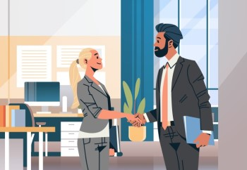 man and woman shaking hands after interview in office