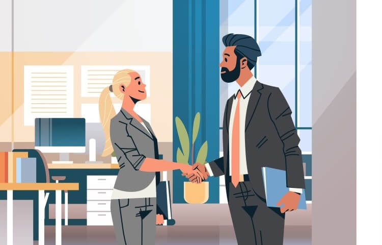 Man and woman shaking hands in an office after a job interview